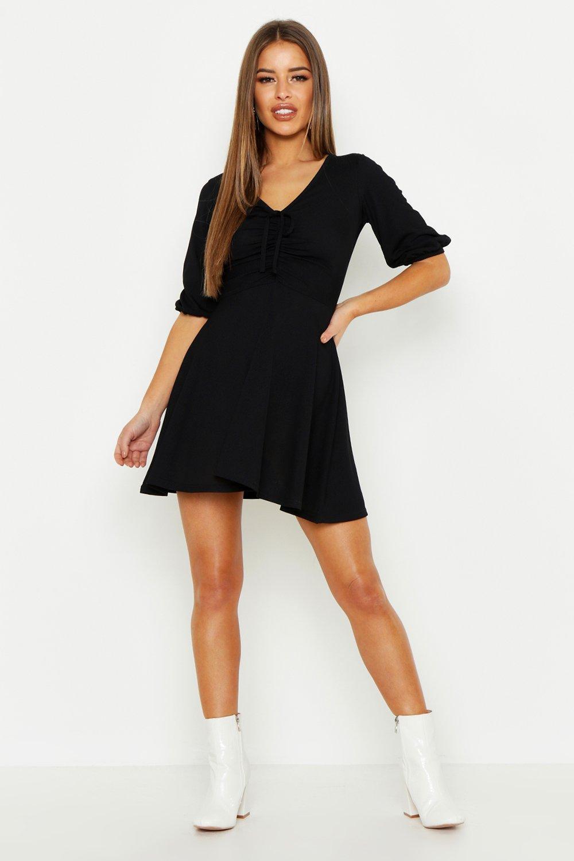 280da94cffb Boohoo. Women s Black Petite Gathered Tie Front Volume Sleeve Skater Dress