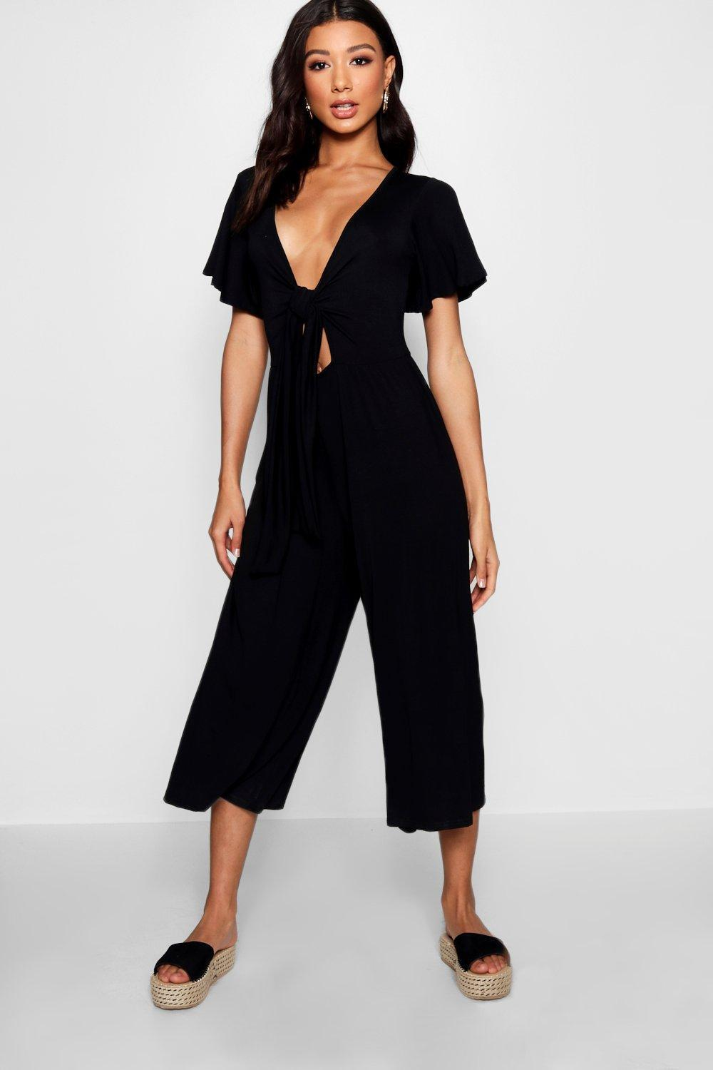 f0f84cd4fa0 Boohoo Tie Front Ribbed Culotte Jumpsuit in Black - Lyst