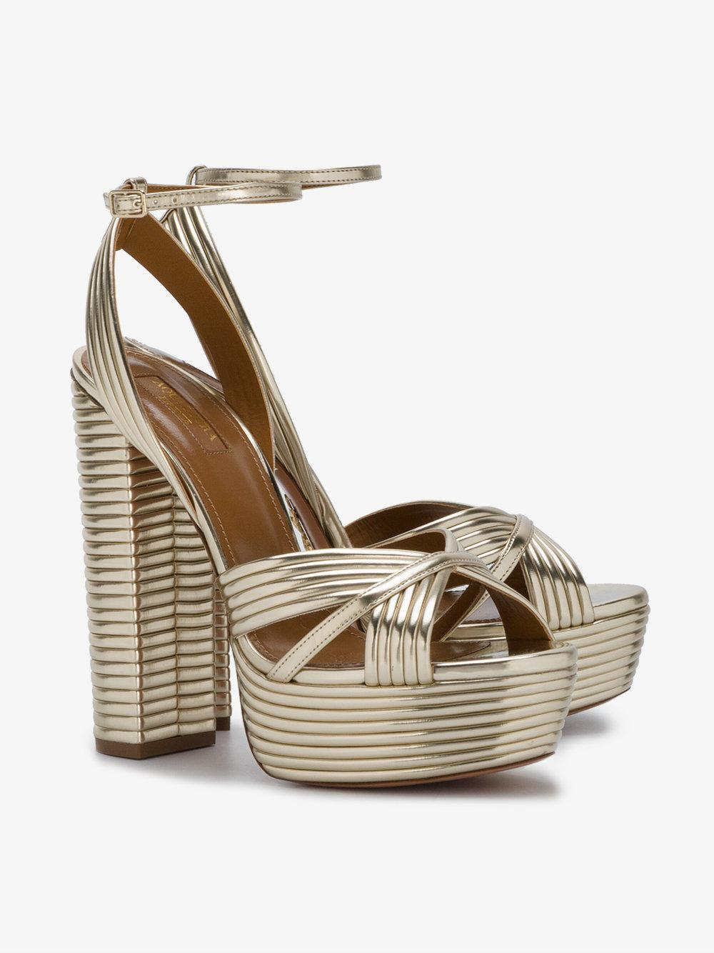 7d62768cab1 Lyst - Aquazzura Gold Sundance 140 Platform Sandals in Metallic