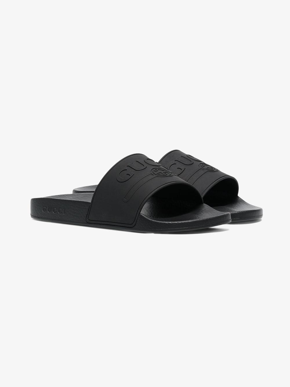 d764ac7e3db Lyst - Gucci Logo Rubber Slide Sandal in Black for Men