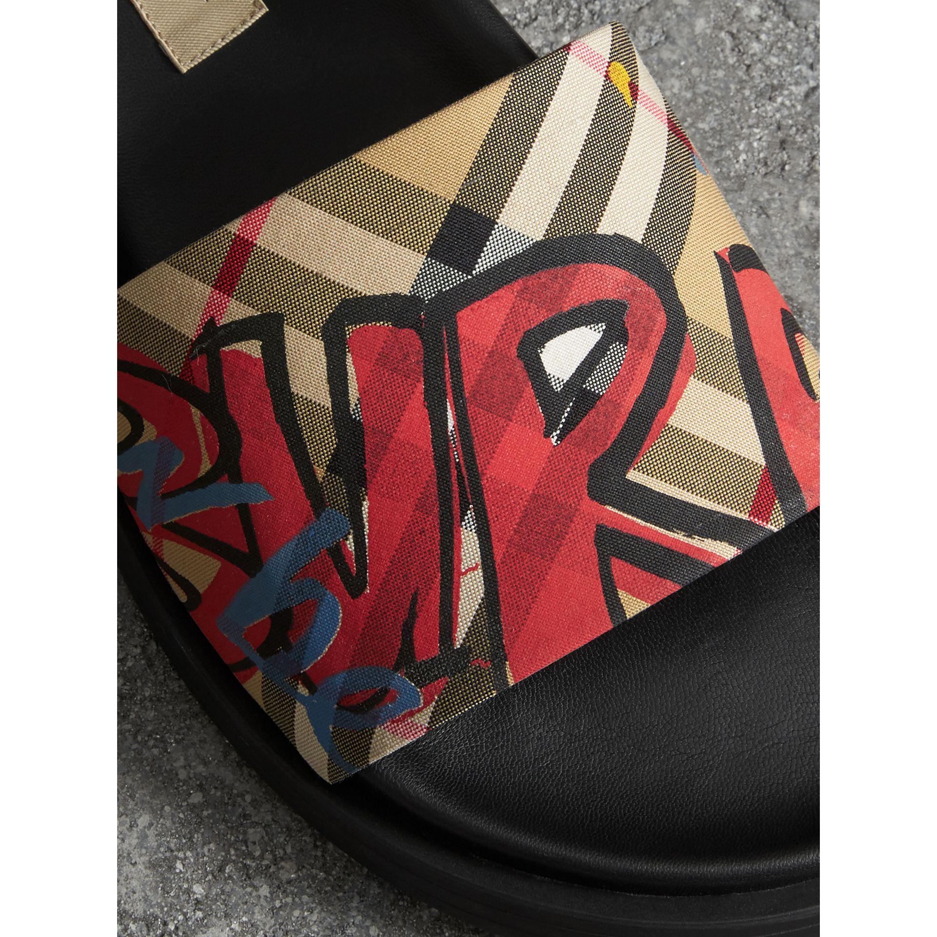 f1ce73fe6ded Lyst - Burberry Graffiti Print Vintage Check And Leather Slides