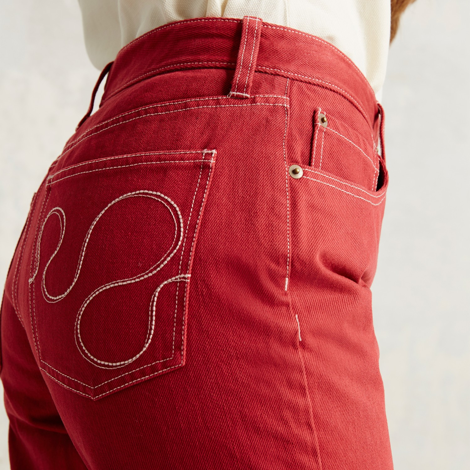Trademark embroidered pocket jean in red lyst