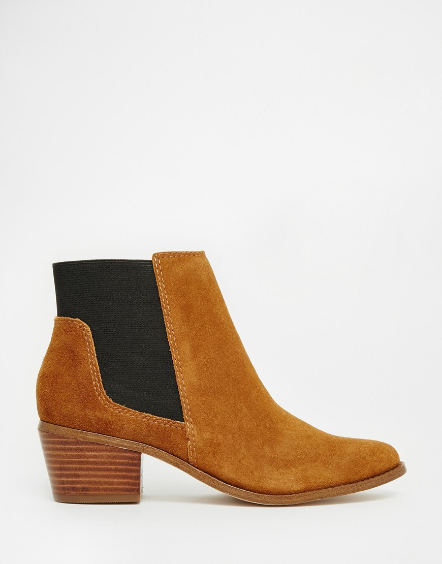 Miss KG Jamila Ankle Boots. Look to the high-octane appeal of Jamila ankle boots by Miss KG for simple elegance year-round. Revamped in a lush suede upper on a metallic gold heel, they are a failsafe option to enhance your favourite fall outfits.