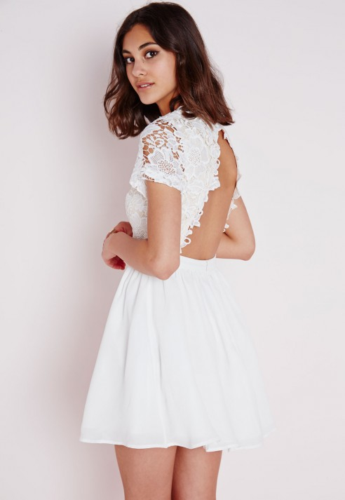 The Lulus Reach Out My Hand White Lace Skater Dress will be there for any fashion emergency! This medium-weight stretch knit dress has a high halter neckline and fitted bodice with princess seams. Panels of sheer lace accent the waist and hem of the flirty skater skirt. Hidden back zipper/5(57).