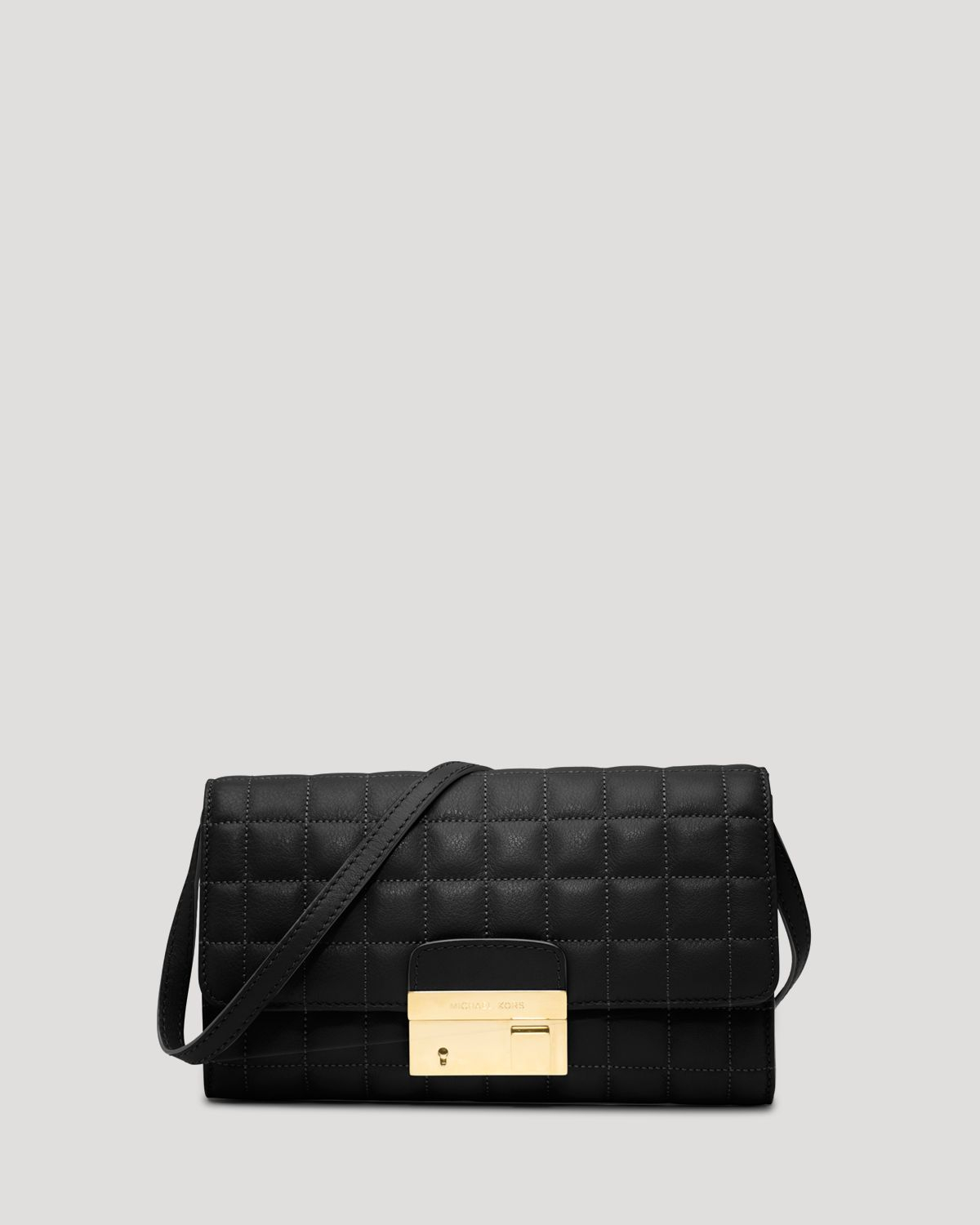 michael kors clutch gia quilted lock in black lyst. Black Bedroom Furniture Sets. Home Design Ideas