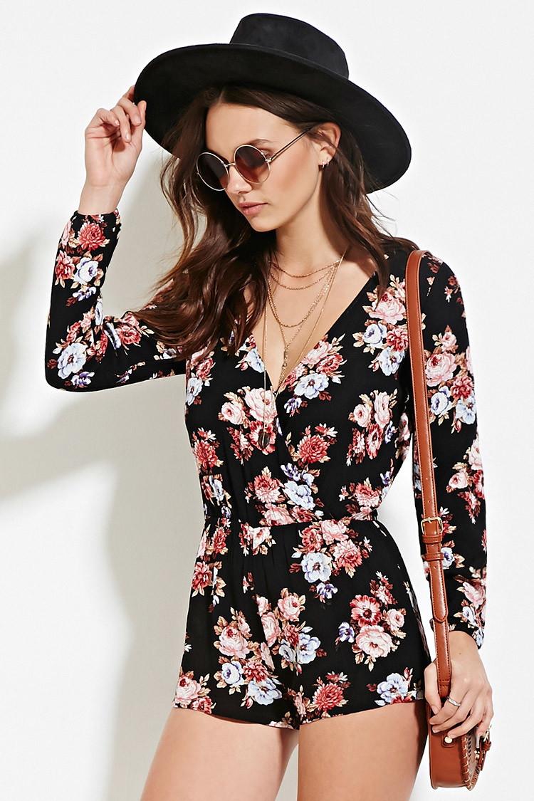 66838de0196 Lyst - Forever 21 Floral Surplice Romper in Black