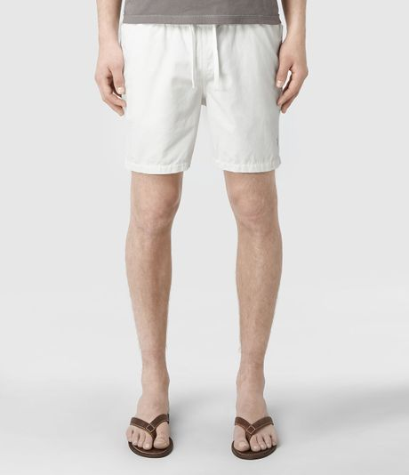 Hybrid shorts are swim trunks that look like regular walking shorts. You can surf in them and then go to lunch with friends without needing to change your clothes. Select a pair made of quick-drying fabric so you don't have to wait long to head to town after coming out of the water.