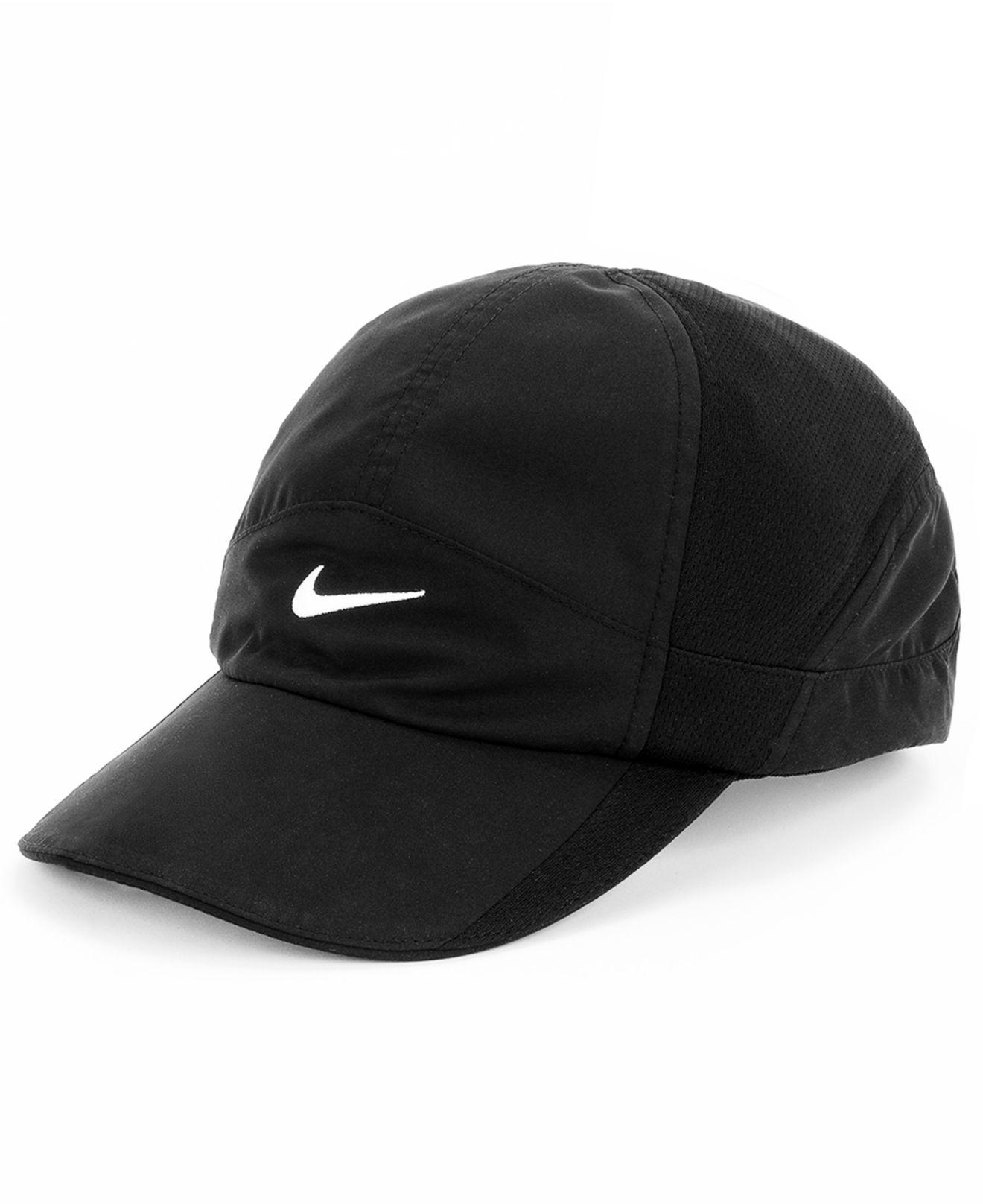 ... shop lyst nike featherlight 2.0 dri fit sports cap in black ba9a1 22a40 1588750a68a