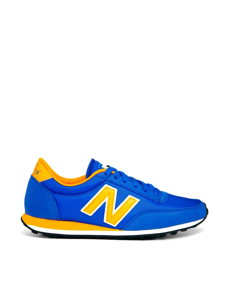 new balance blue yellow 410 trainers