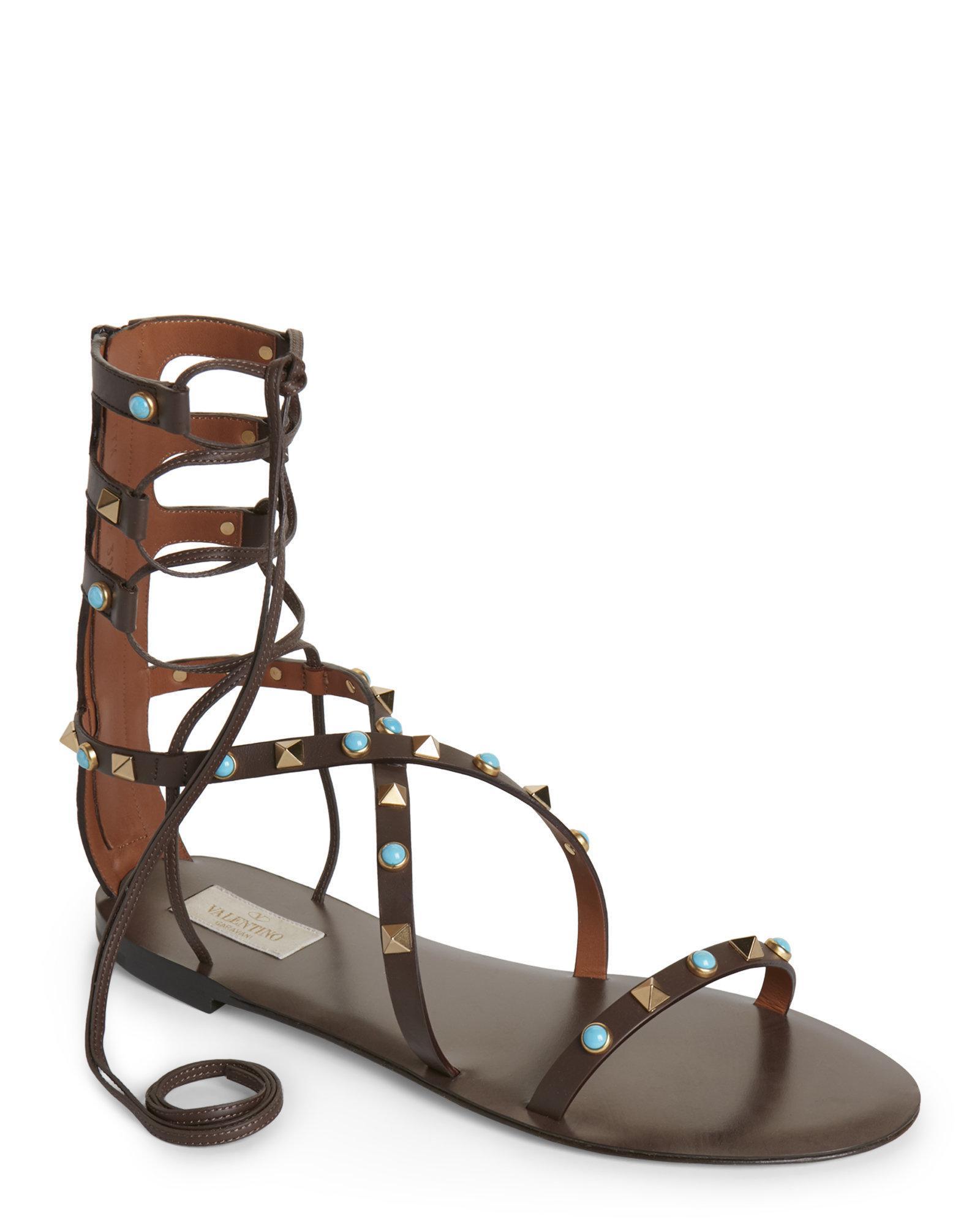 4962a7741983 Lyst - Valentino Rockstud Rolling Flat Gladiator Sandals