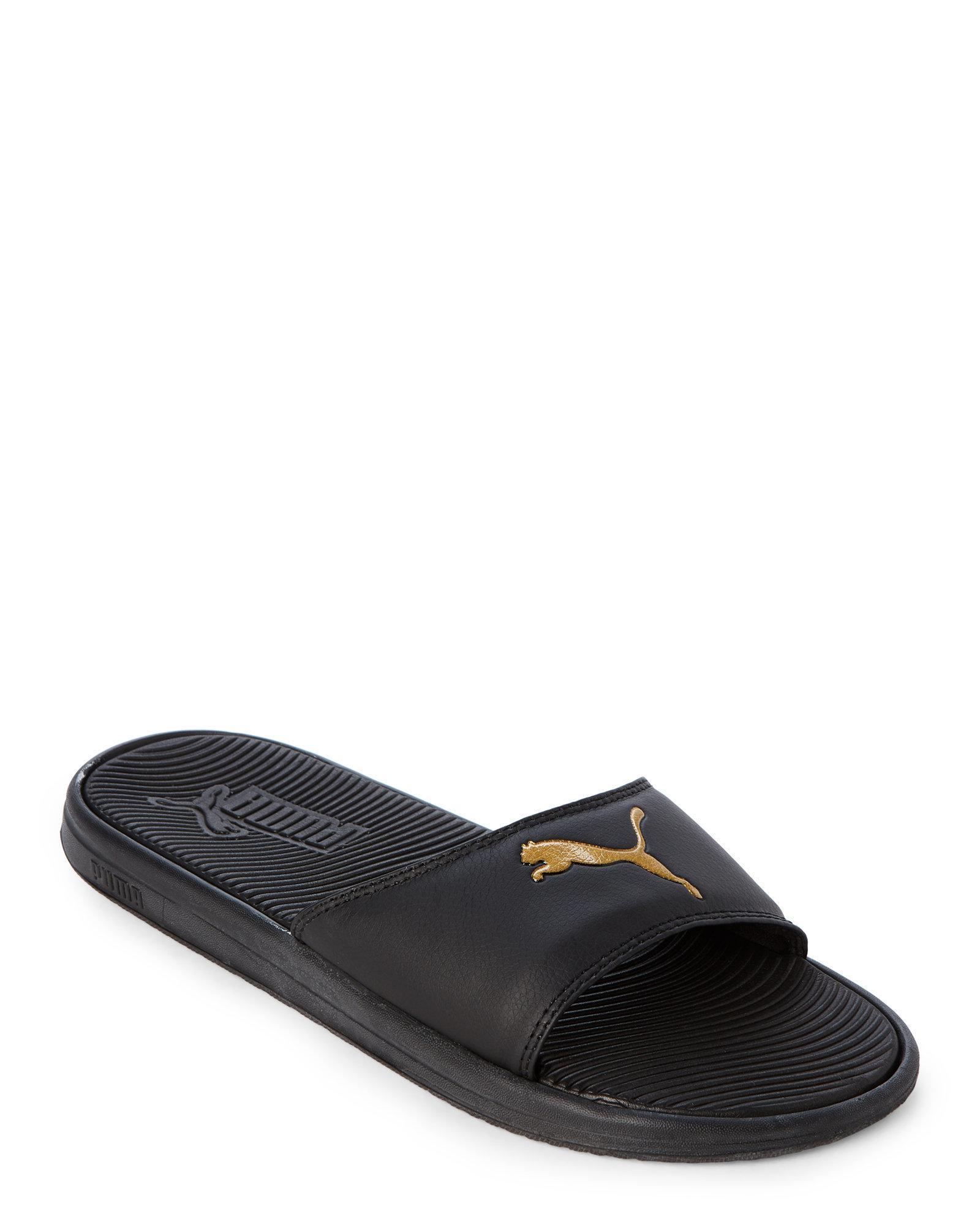 f40e41ddec7a ... cheap lyst puma black gold sport slides in black for men c8640 d92f9