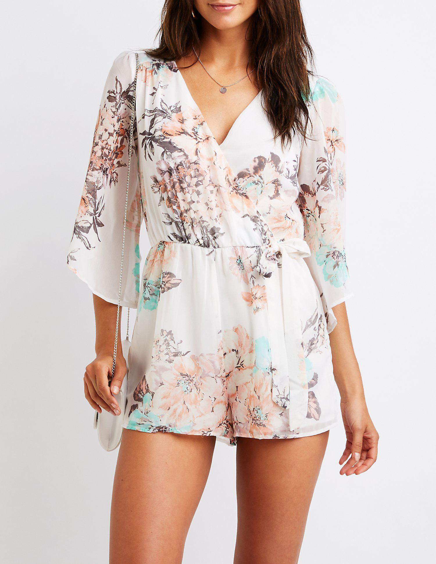 8ef1416aa3ad Lyst - Charlotte Russe Floral Open Back Wrap Romper in White