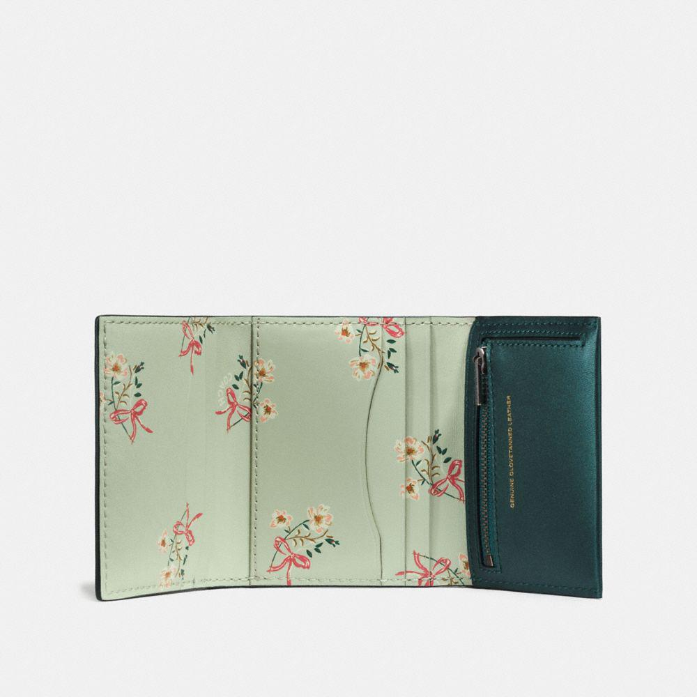 39efd15ec9 ... discount code for lyst coach small trifold wallet with floral bow print  interior in 32ccf ddd0a low cost green leather ...