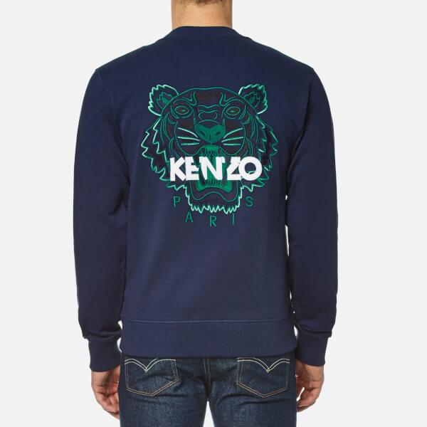 Click here to shop the hottest pieces from Kenzo. AW16 now live online including the iconic tiger T-shirts and jumpers alongside an exclusive collection of .