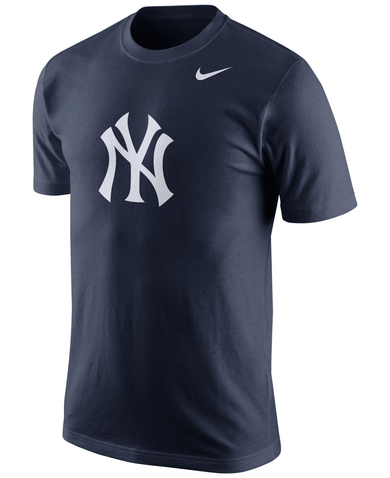 Nike men 39 s new york yankees logo t shirt in blue for men for Navy blue and white nike shirt