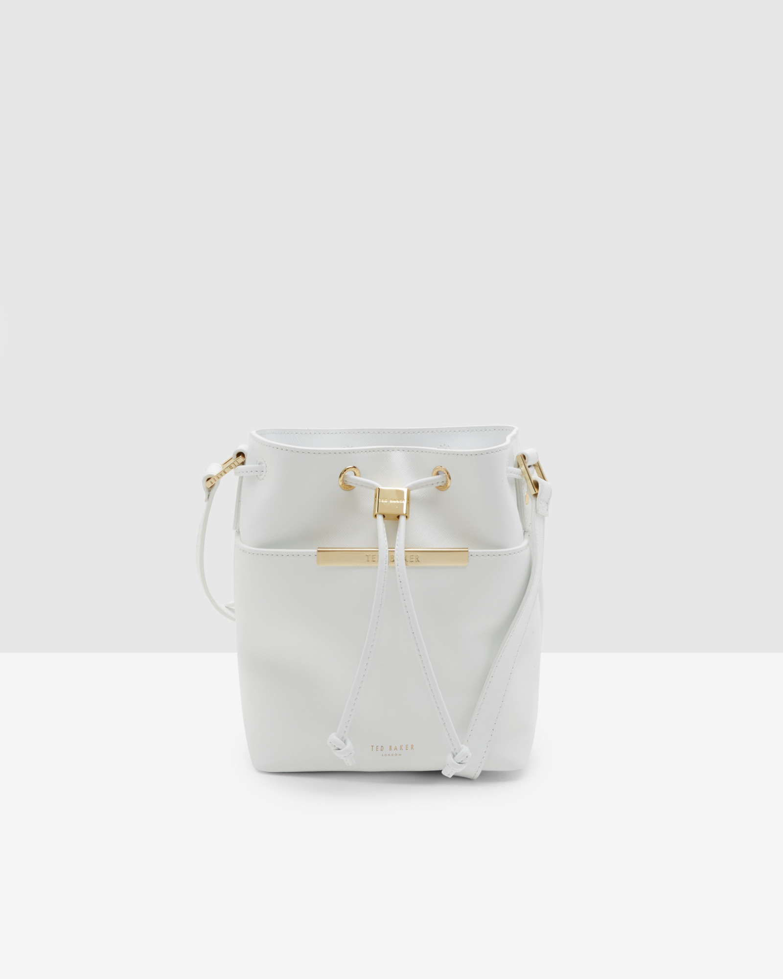 29fc77c03a284a Lyst - Ted Baker Crosshatch Leather Mini Bucket Bag in White