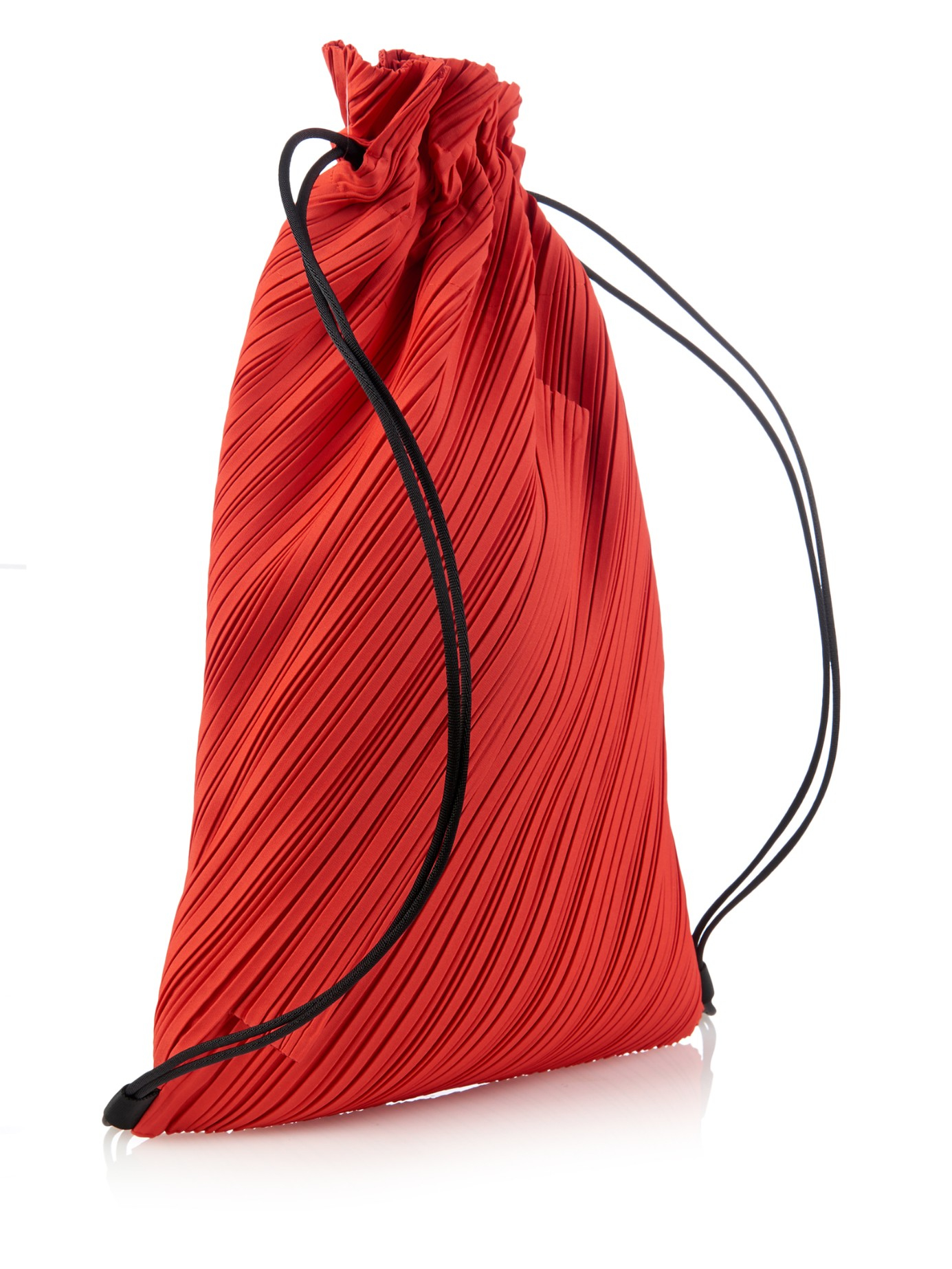 Lyst - Pleats Please Issey Miyake Pleated Drawstring Backpack in Red a7e0015bb2f8f
