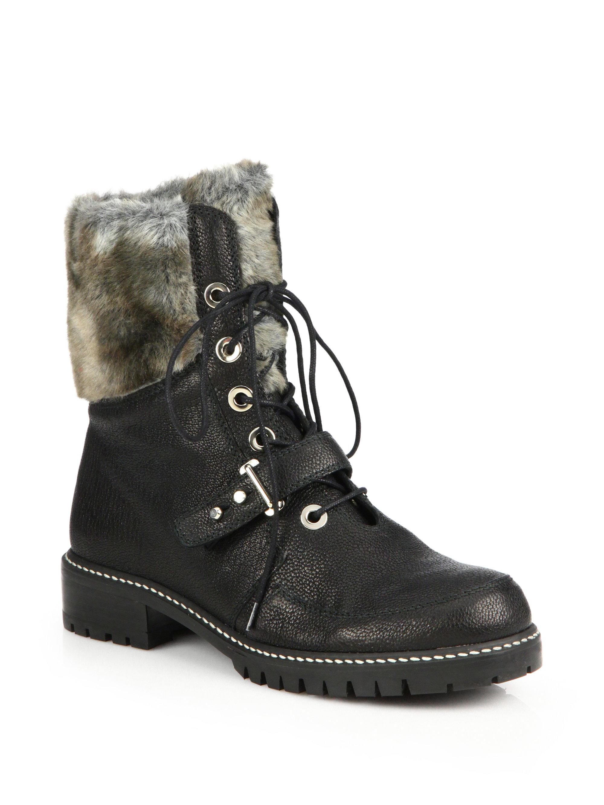 stuart weitzman viking leather faux fur lace up boots in black lyst. Black Bedroom Furniture Sets. Home Design Ideas