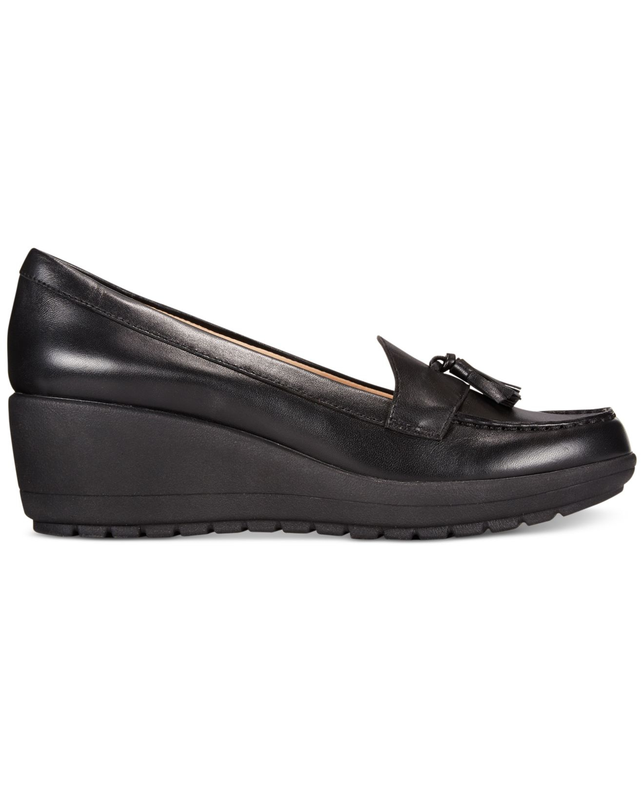 A foam wedge adds a dramatic lift to these polished leather See by Chloé loafers. Scalloped trim and piping trims the top line and tassels accent the vamp. Rubber sole.