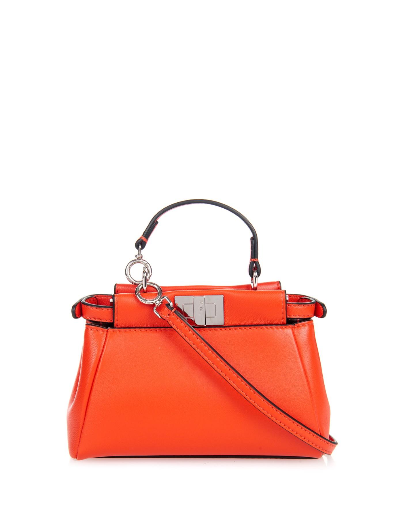 de74358ac1b3 ... shop lyst fendi micro peekaboo leather cross body bag in orange fbd2e  58bd4