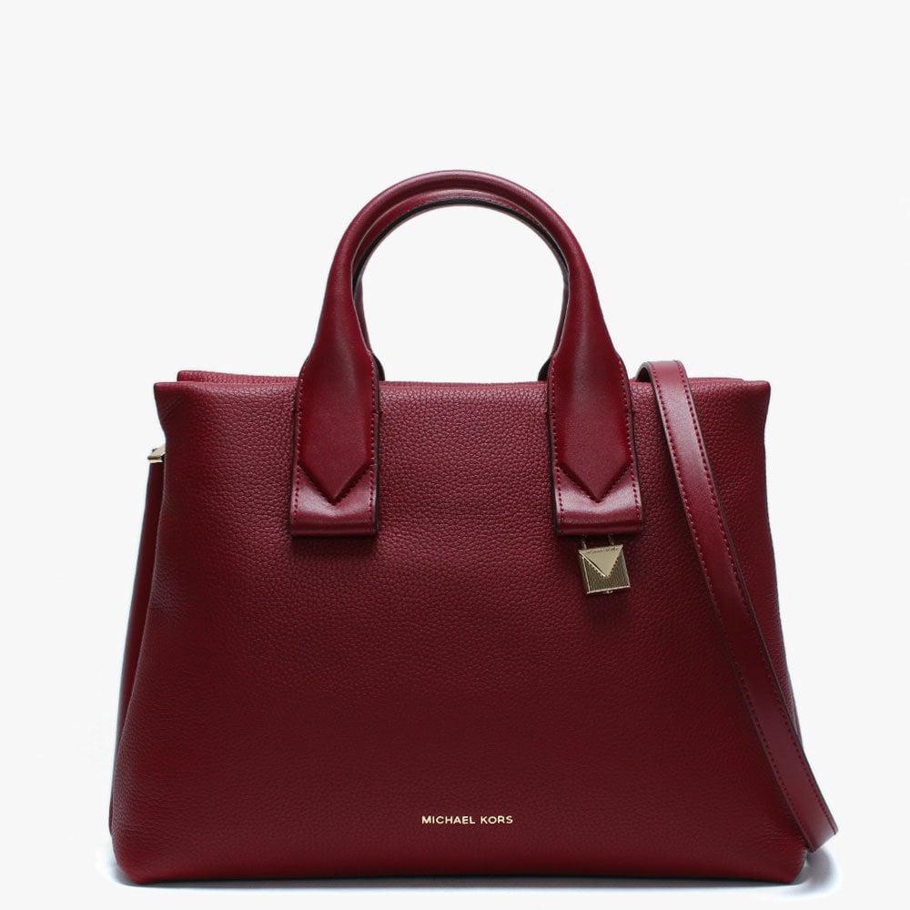 35579aca8aa4 ... sweden michael kors purple large rollins maroon pebbled leather satchel  bag lyst. view fullscreen a0c75