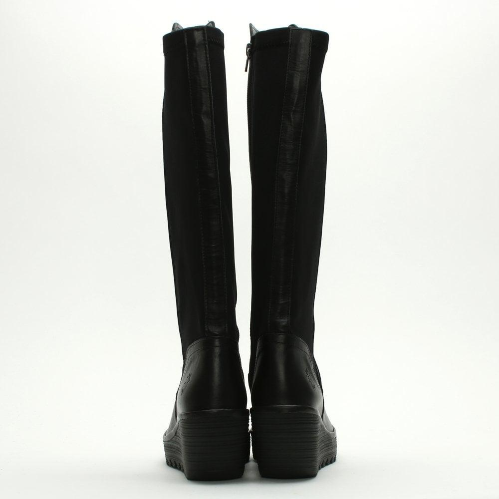 d7f5691385b4 Lyst - Fly London Yeve Black Leather Stretch Back Wedge Knee Boots ...