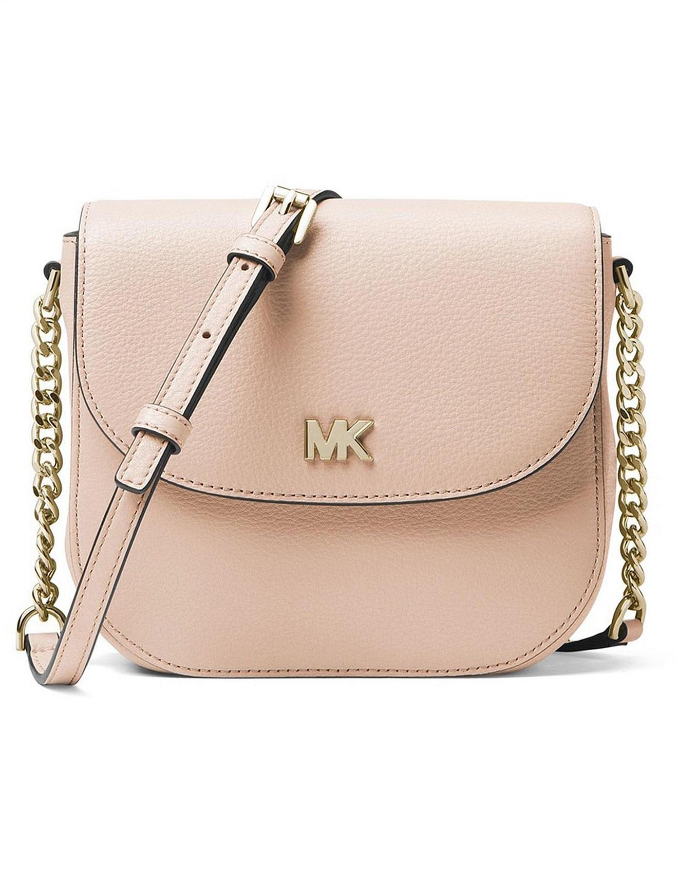 fcacd975eb2b Michael Kors Mott Pebbled Leather Dome Crossbody in Pink - Lyst