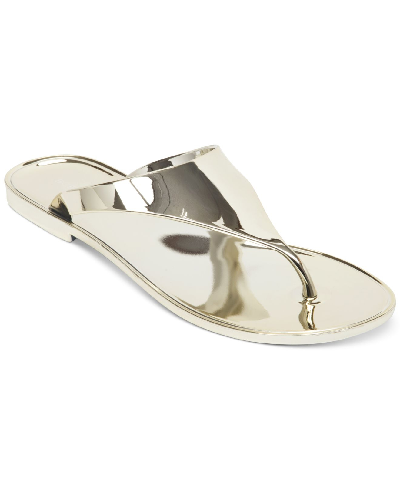 be5022c0d6f2 Lyst - BCBGeneration Starr Flat Thong Sandals in Metallic