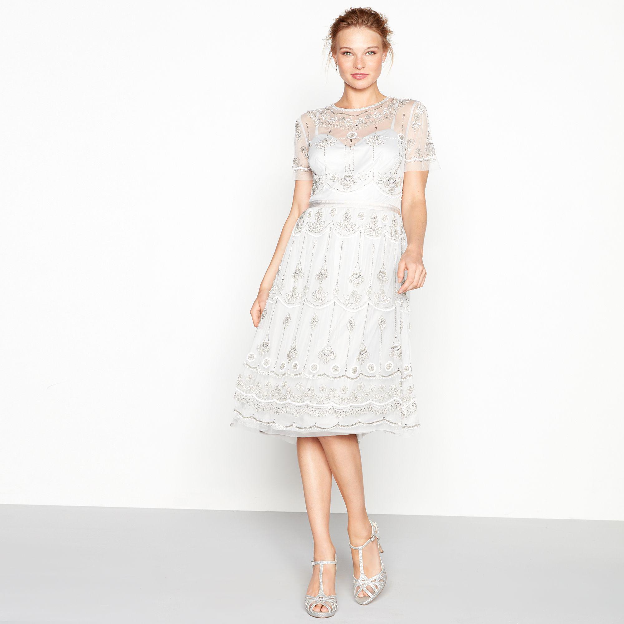 77519d1f970 Jenny Packham. Women s Metallic Silver Embroidered Round Neck Short Sleeve  Midi Evening Dress