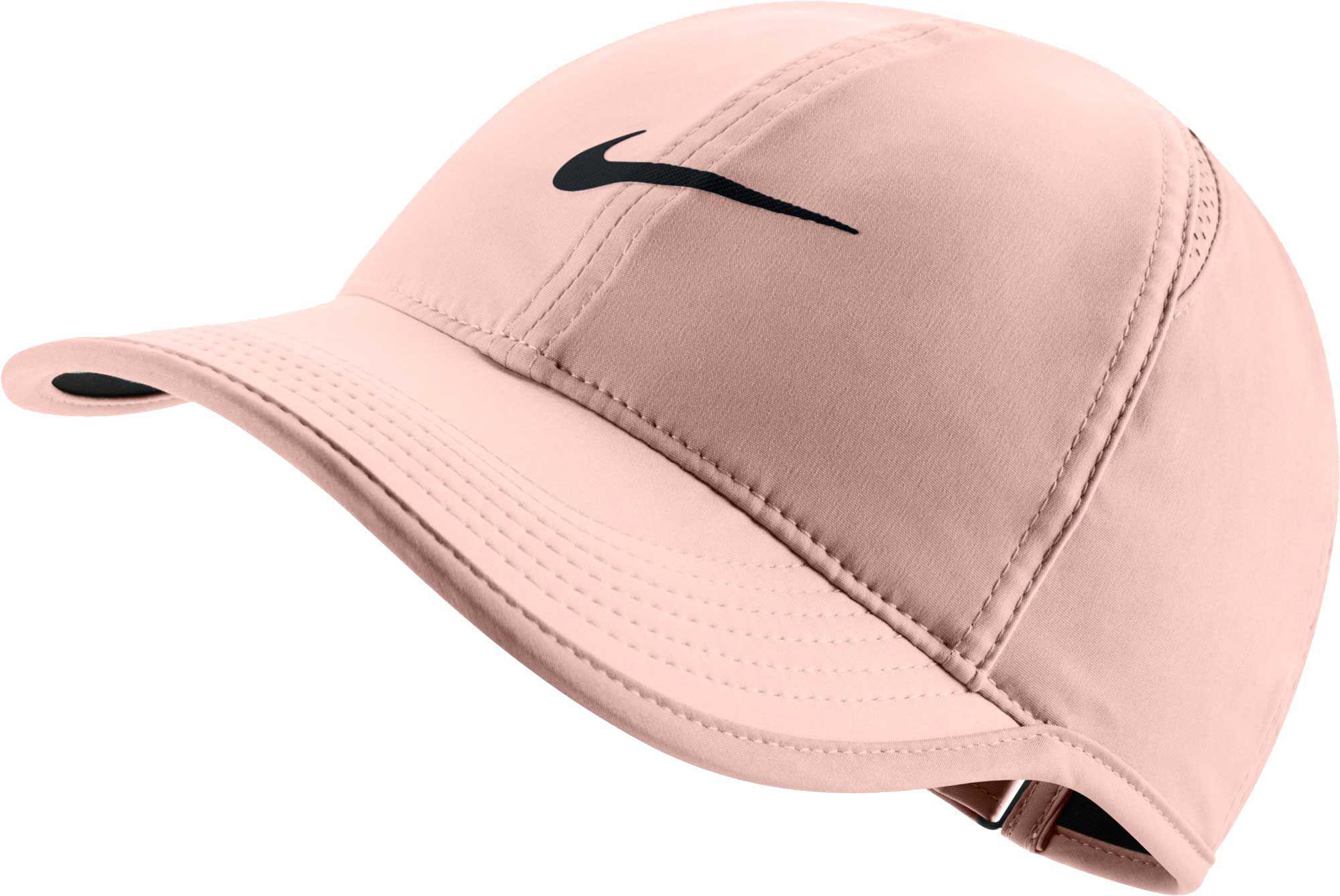 ... dri fit adjust cap hat 93c5d a50de  discount code for nike. womens pink  feather light adjustable hat 35cbc 245c1 d3f06c311750