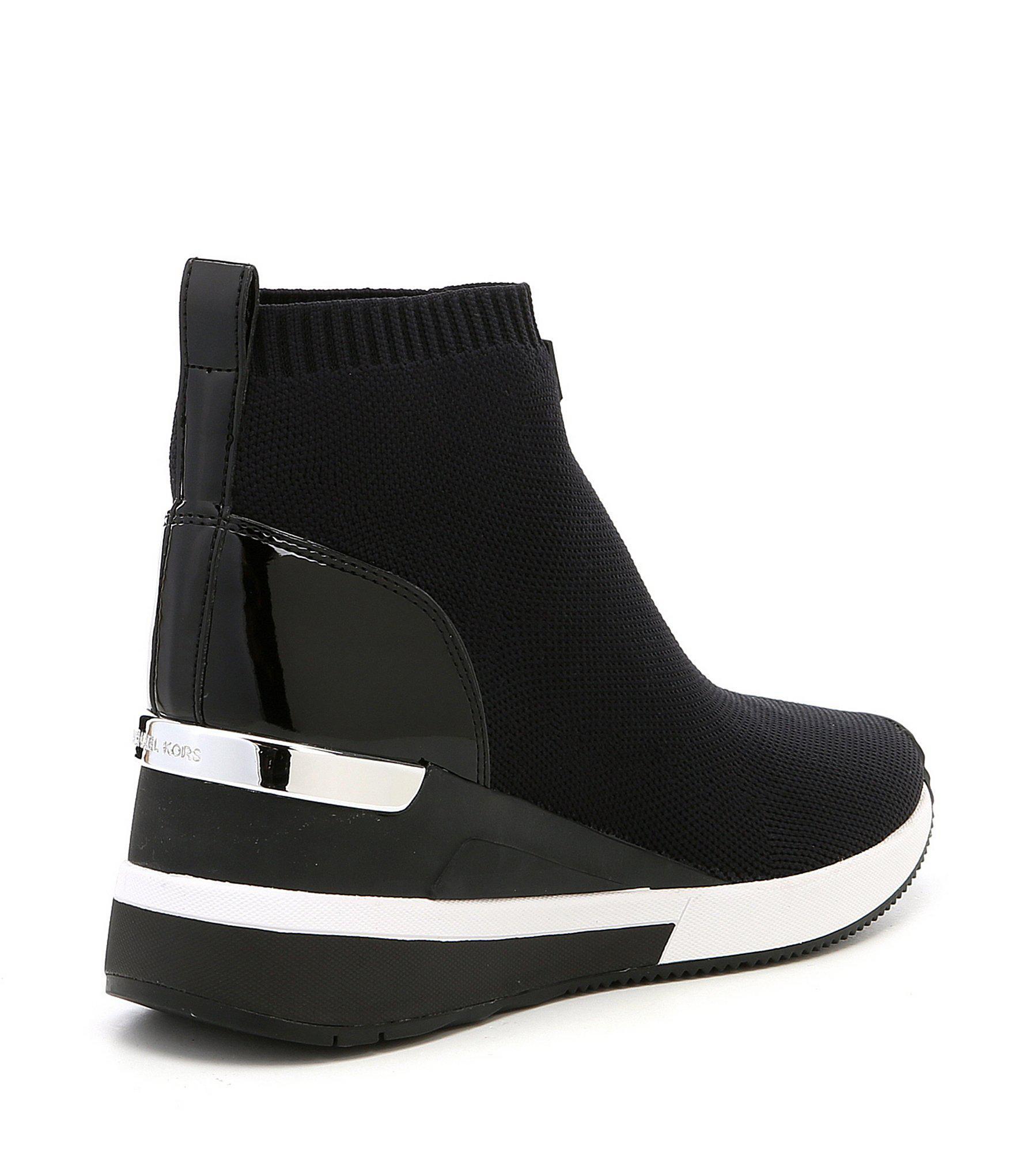 d074cb782b0 MICHAEL Michael Kors - Black Skyler Wedge Sneaker Booties - Lyst. View  fullscreen