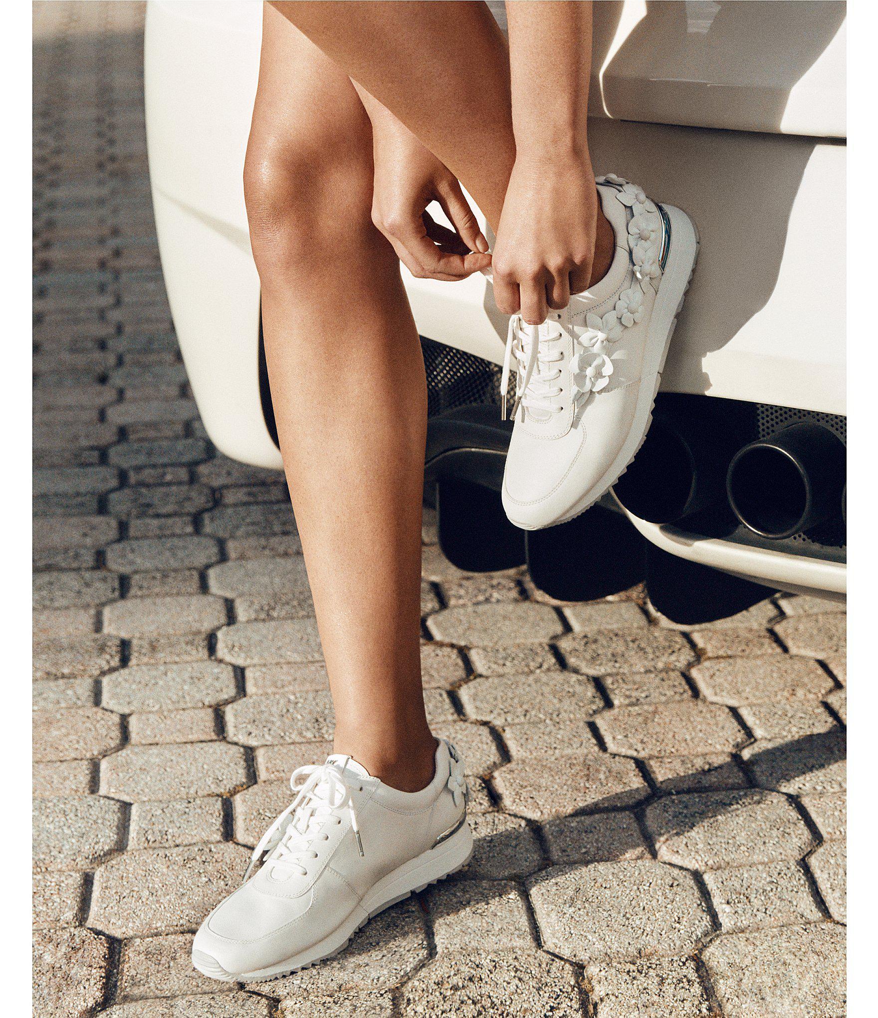 c221f883faed Lyst - MICHAEL Michael Kors Allie Leather Floral Applique Trainer ...