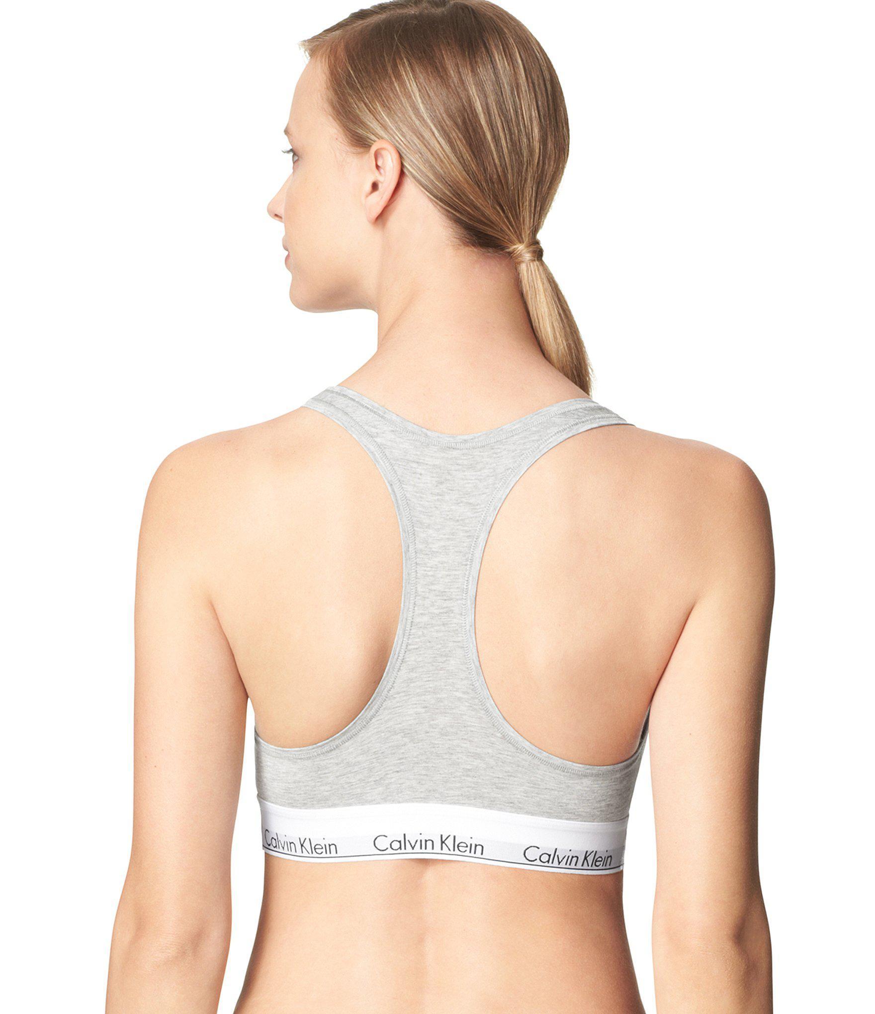 ce558979c14551 Lyst - Calvin Klein Modern Seamless Racerback Sports Bralette in Gray