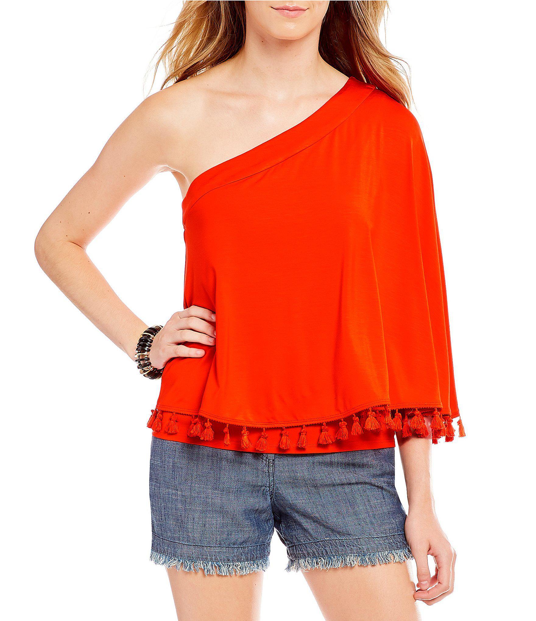 8be8a0aeac7db5 Lyst - Trina Turk Pomona Knit Jersey Tassel Trim One Shoulder Top