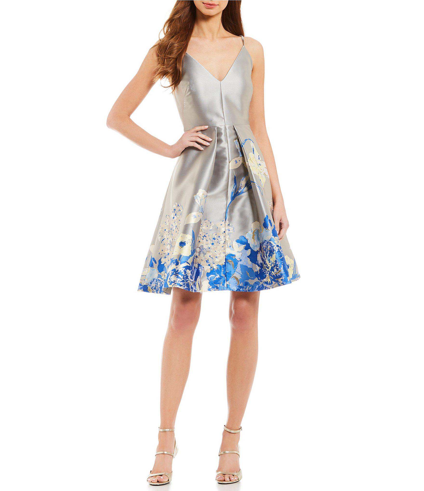 df7cb2be3b92c5 Lyst - Calvin Klein Floral Print Pleated Waist Dress in Blue