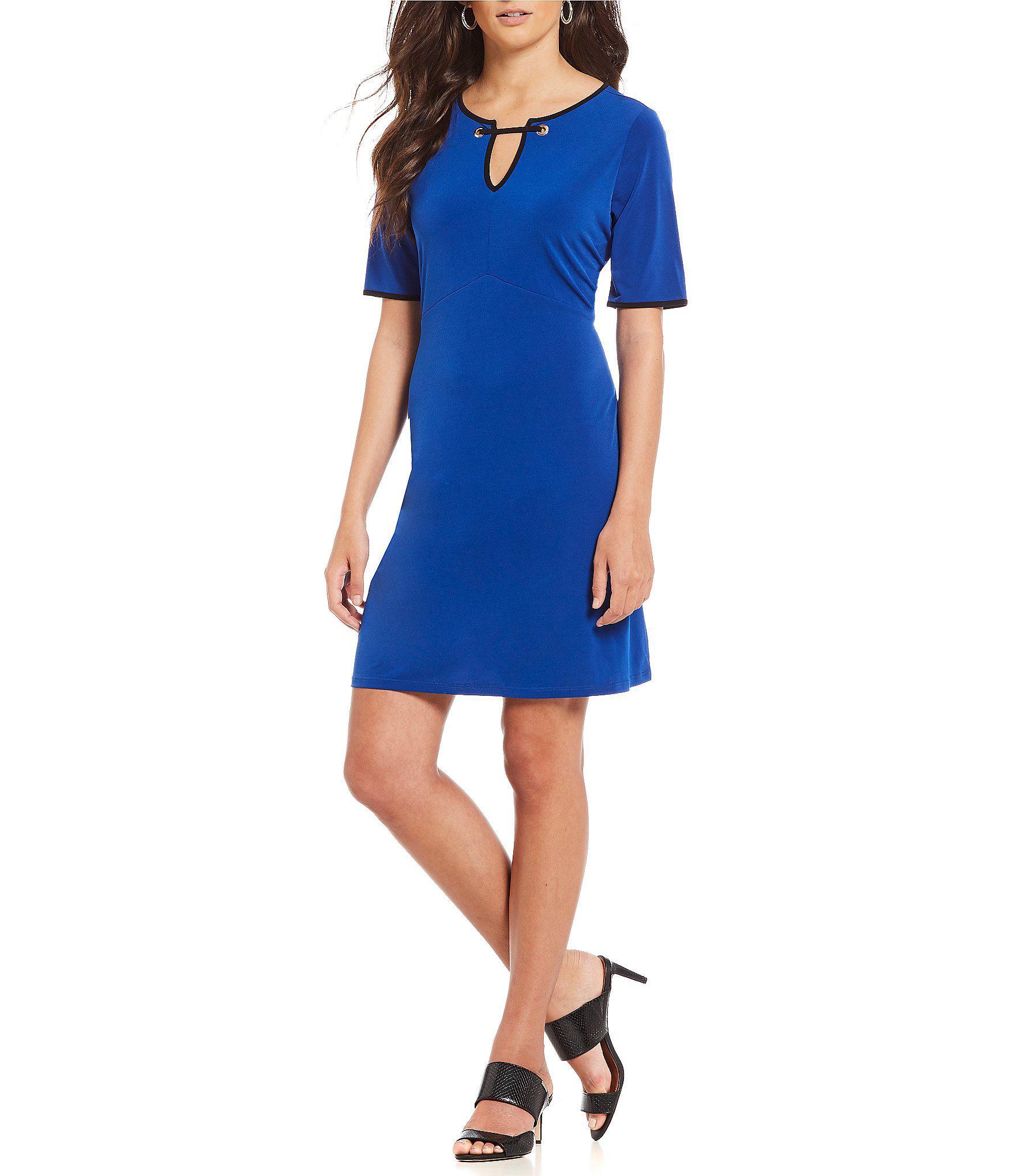 70c2e9c03ea Ivanka Trump - Black Matte Jersey Grommet Trim Split Neck Short Sleeve Dress  - Lyst
