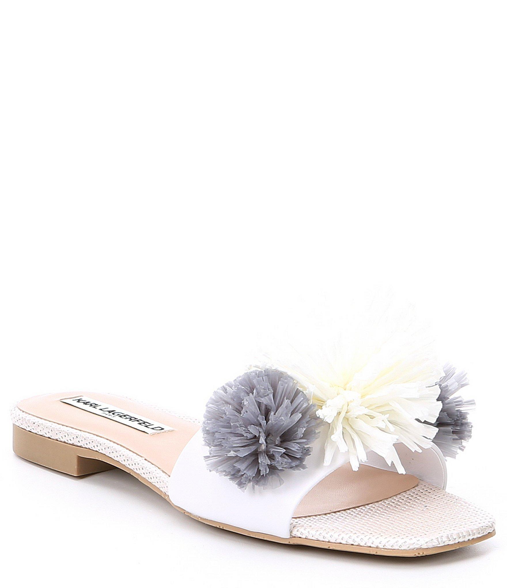 b52aa0919876 Lyst - Karl Lagerfeld Rainey Leather Pom Pom Slides in White - Save 42%