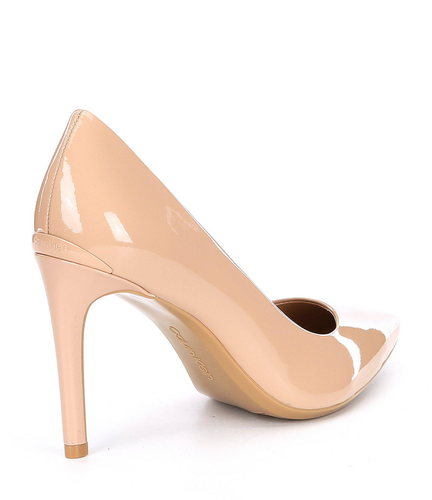 11d7cabe191 Lyst - Calvin Klein Ronna Patent Leather Pumps in Natural