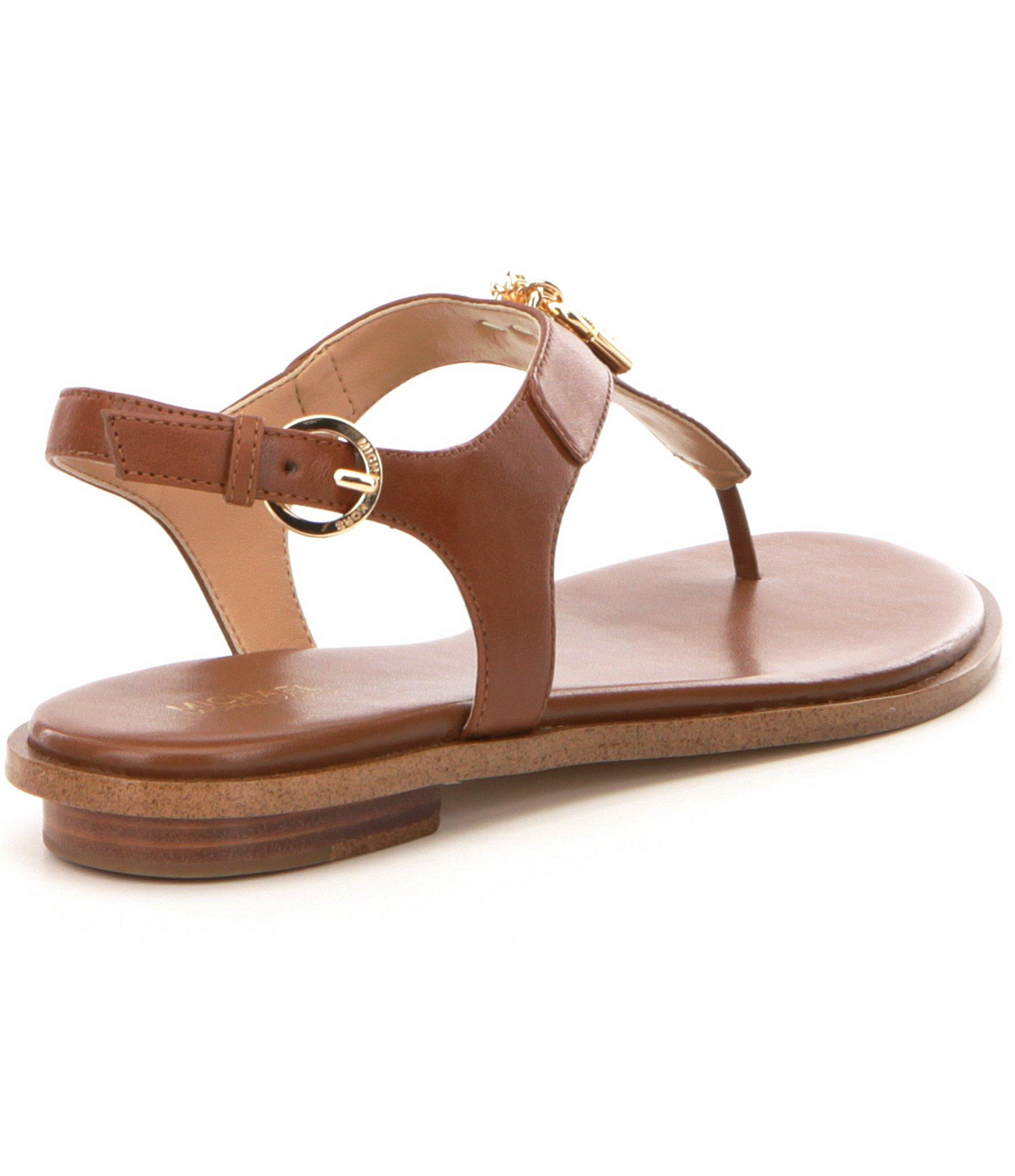 5c0583db69ef MICHAEL Michael Kors - Brown Suki Leather   Charms Thong Sandals - Lyst.  View fullscreen