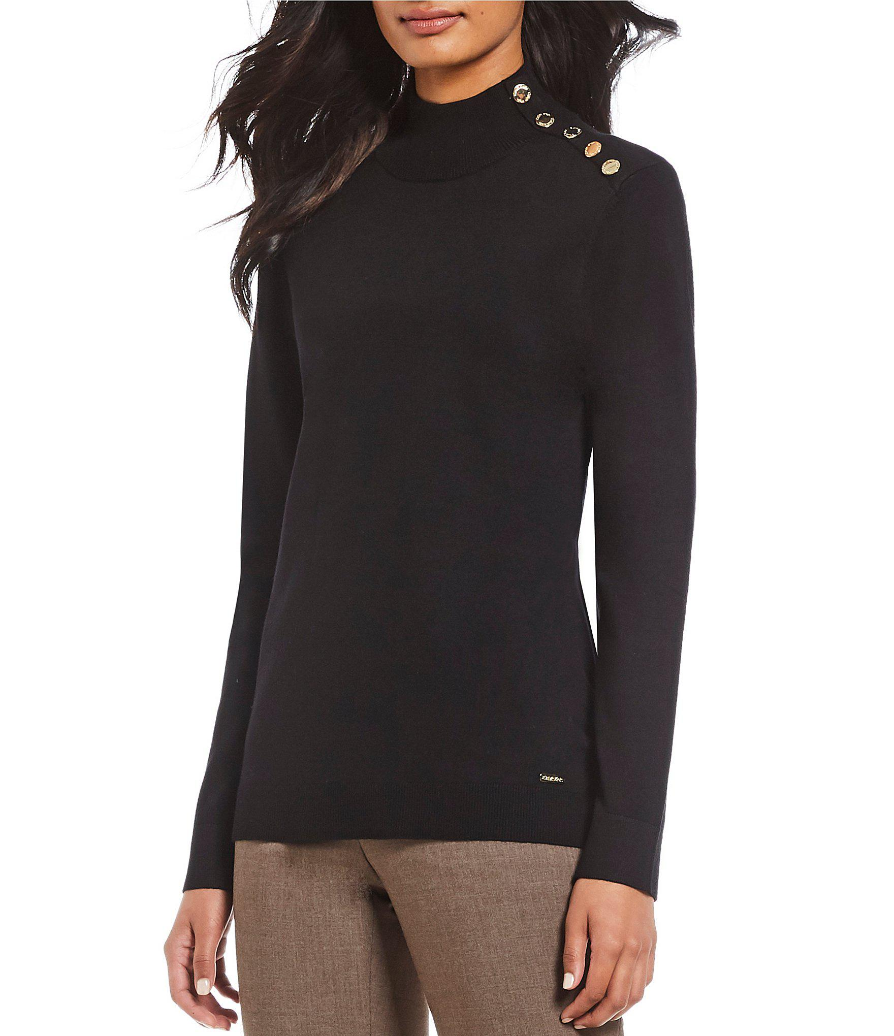 584bc6c43137a Calvin Klein. Women s Black Button Embellished Shoulder Mock Neck Sweater