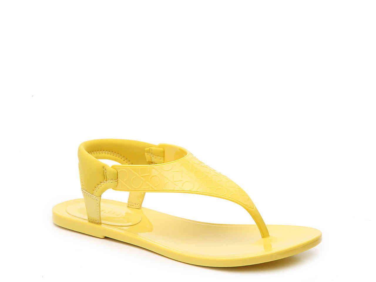 1bf827d80fb4 Lyst - Calvin Klein Janny Jelly Sandal in Yellow