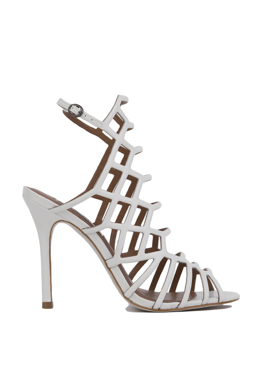 25b4a119a17 Lyst - Steve Madden Slithur Caged Heeled Sandals in White