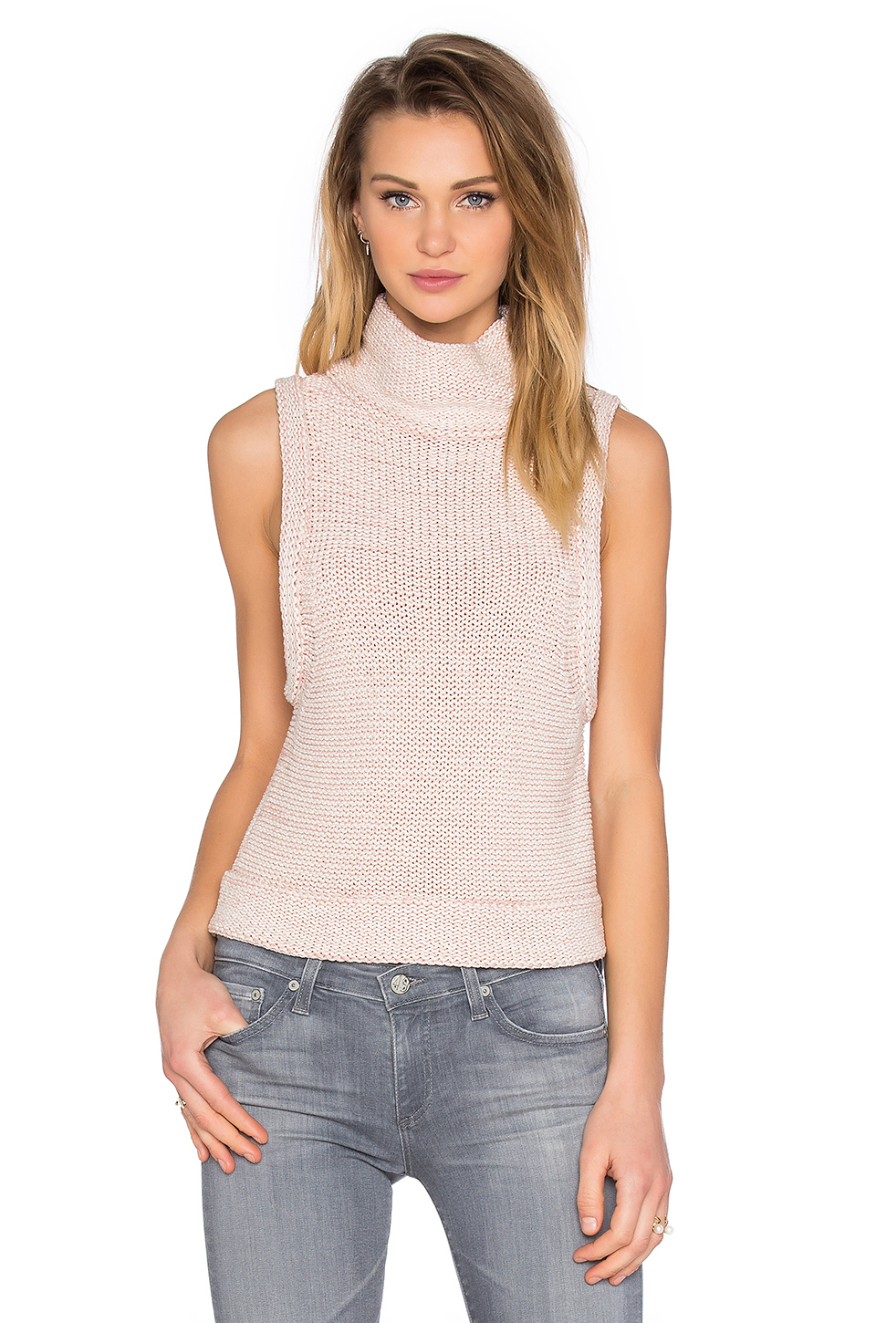 When the brutal cold of deep winter really sets in, more than one top is the secret to survival. The least bulky combo? A sleek turtleneck bodysuit with sleeveless crewneck on top, for a cozy.