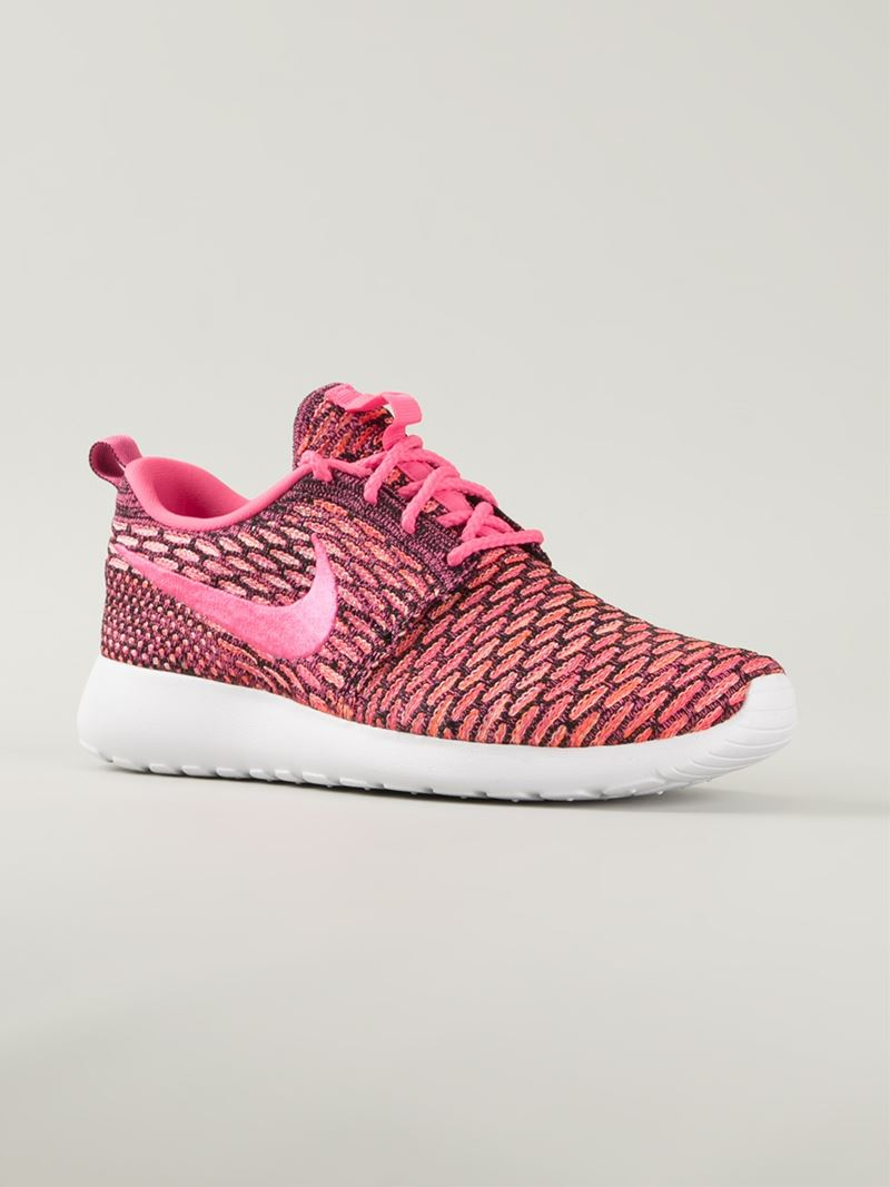 lyst nike roshe run flyknit sneakers in pink. Black Bedroom Furniture Sets. Home Design Ideas