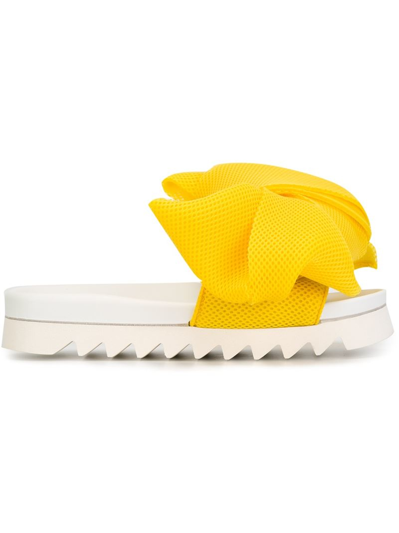 937ab6a62a1b Lyst - Joshua Sanders Oversized Bow Slide Sandals in Yellow