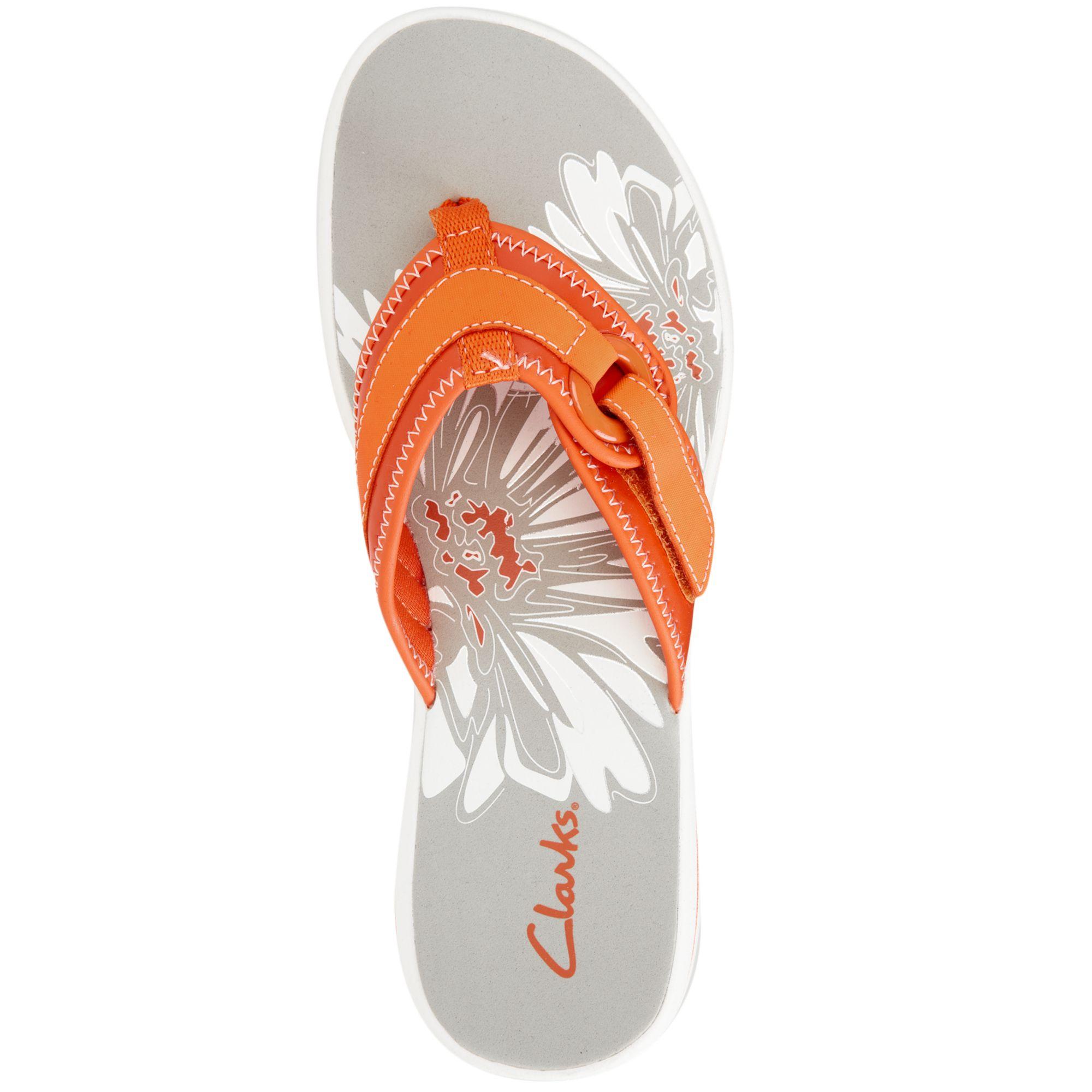 5ea1c13a1c03 Lyst - Clarks Womens Shoes Breeze Mila Flip Flops in Orange