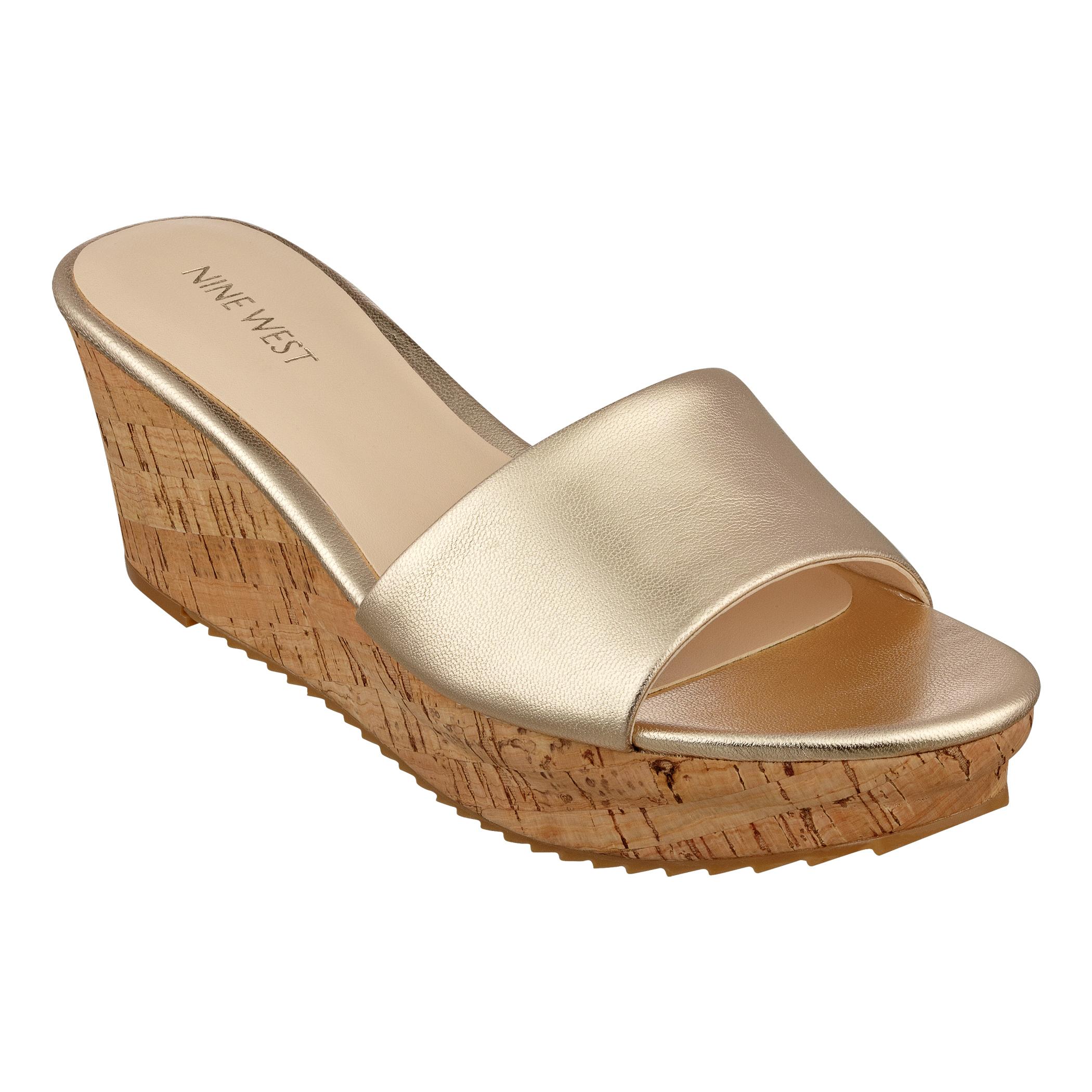 e81819842e3 Lyst - Nine West Confetty Wedge Sandals in Metallic
