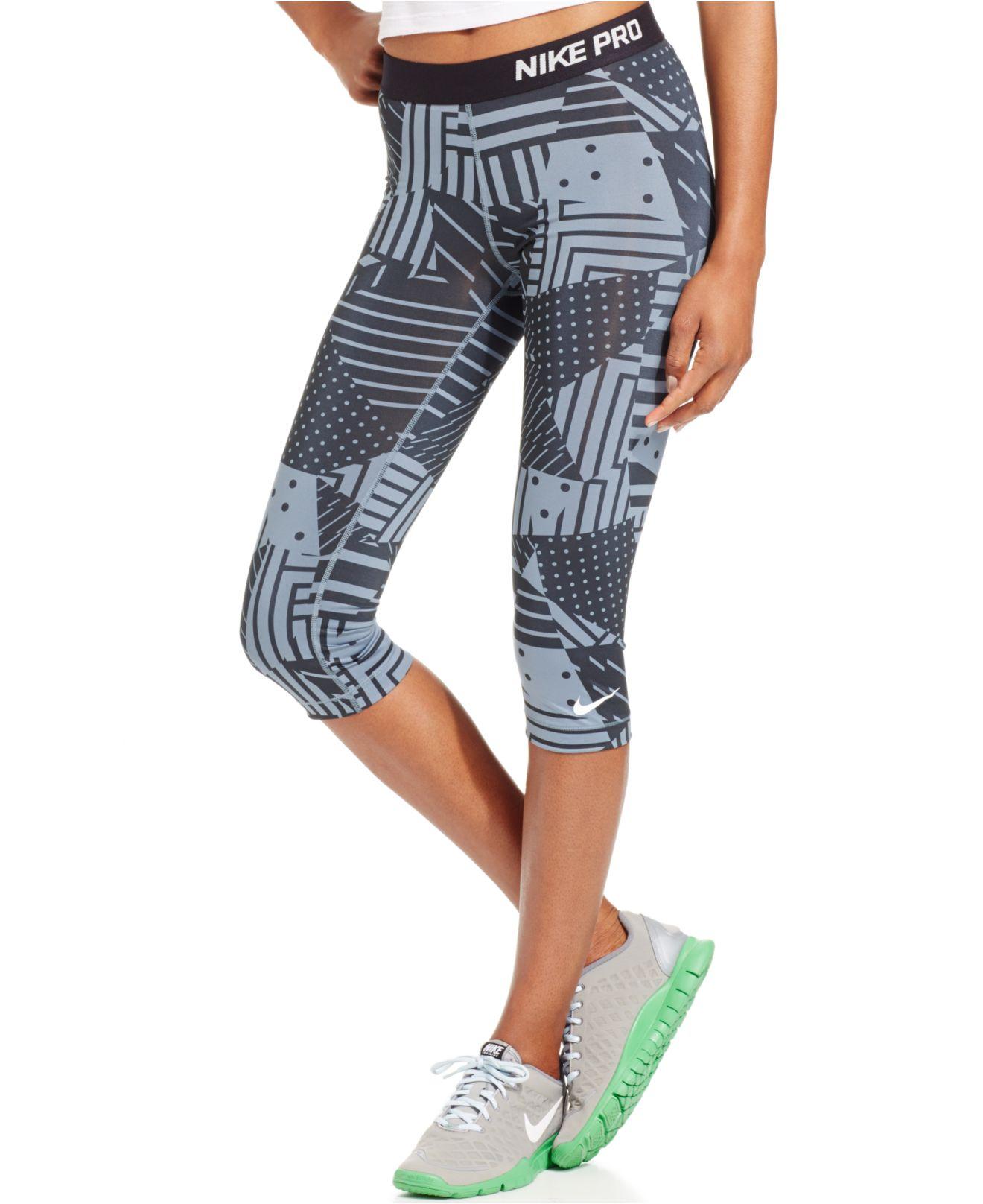 98ddb20de0f3 Lyst - Nike Pro Patchwork Printed Capri Leggings in Black