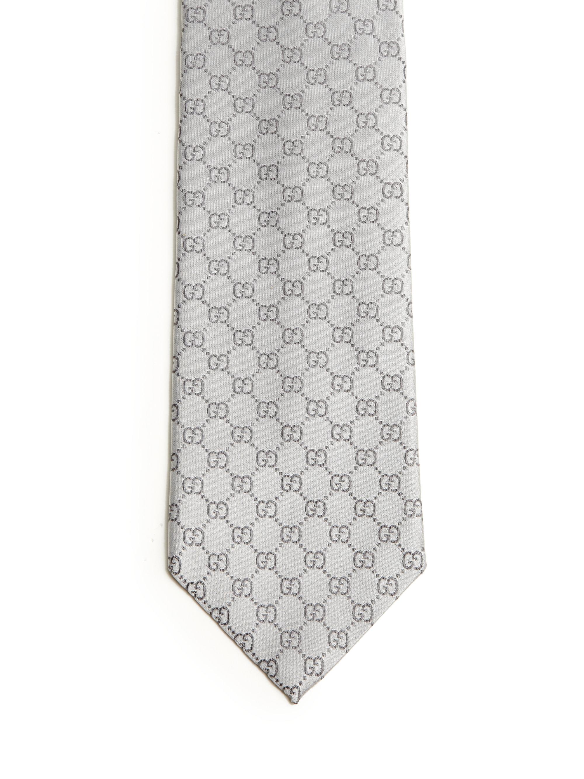 gucci silver monogrammed silk jacquard tie in metallic for men