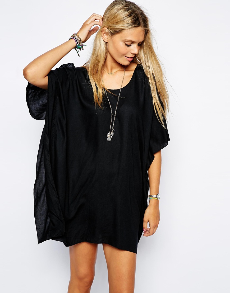 Asos cold shoulder beach cover up in black lyst for Beach shirt cover up
